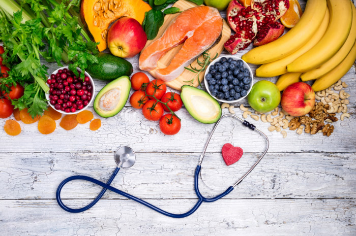 Fresh fruit and vegetables with a heart and stethoscope