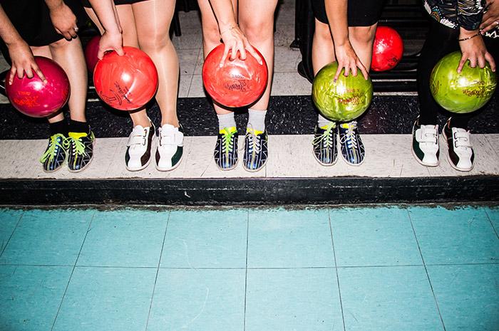 Team mates playing bowling