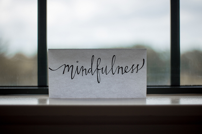 Piece of paper up against window sill reading MINDFULNESS