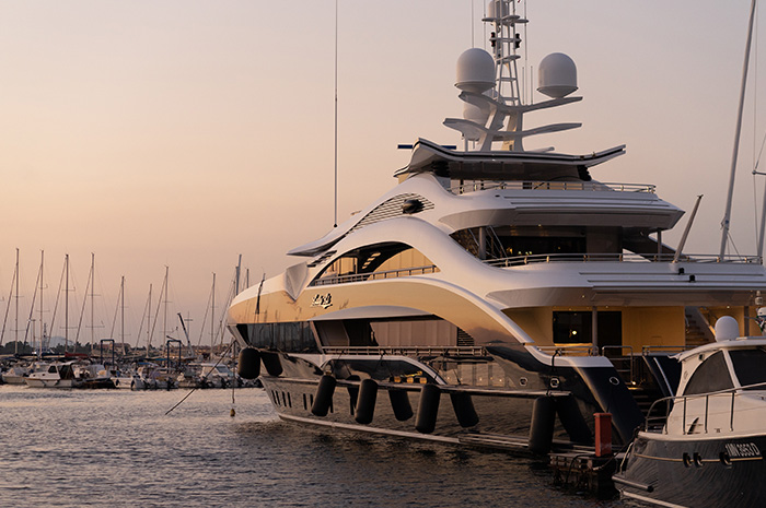 Luxurious yacht docked in harbour