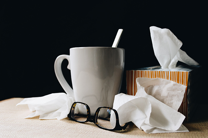 Coffee mug with glasses and tissues