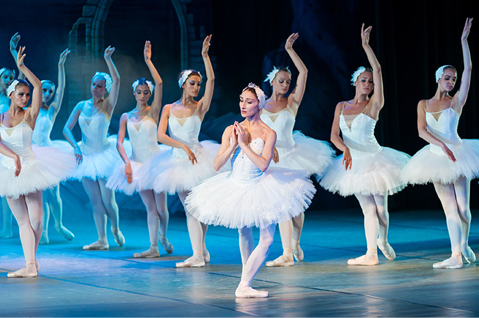 Ballerinas performing on stage in tutus