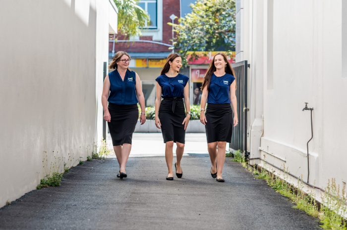 DGL Accountants staff walking down alley way talking and laughing
