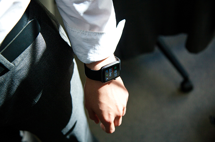 Business man with smart watch tracking fitness and activity