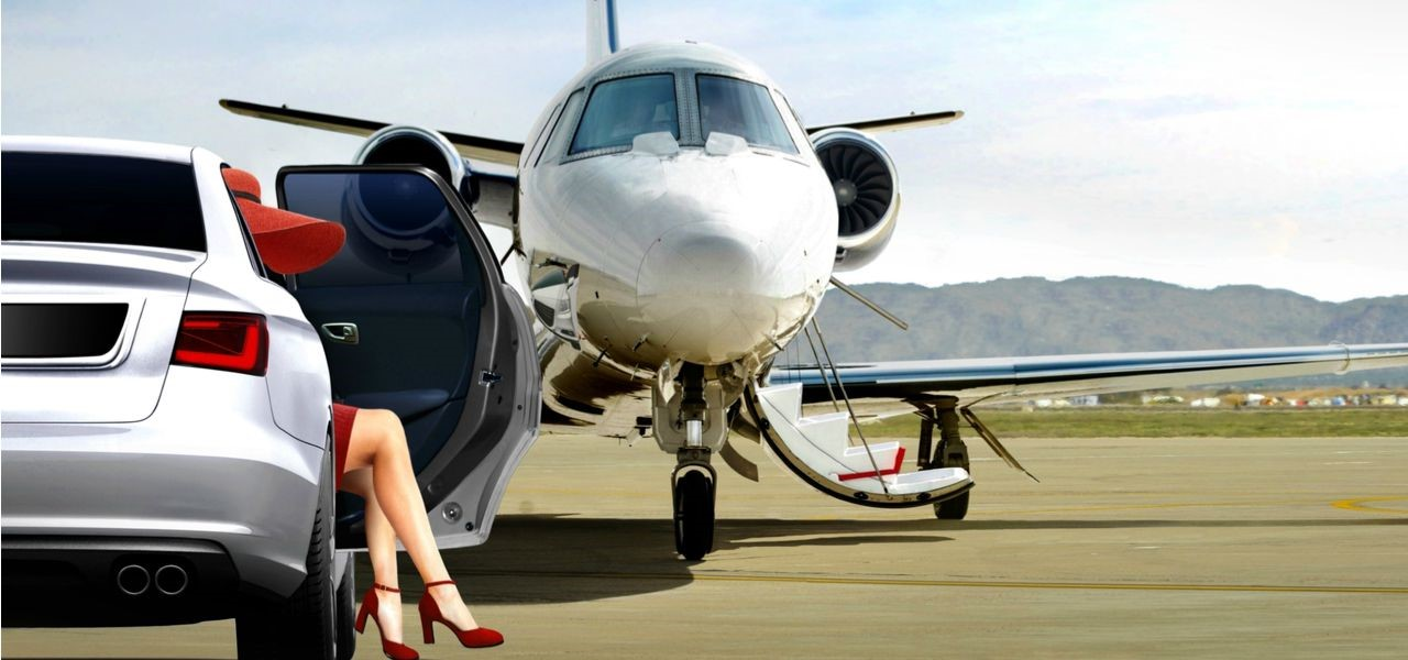 Wealthy lady sitting in expensive car in front of private jet